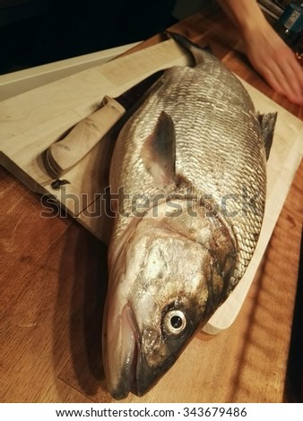 fresh fish on a kitchen table - stock photo