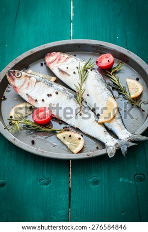 fresh fish on wooden table - stock photo
