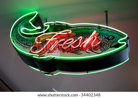 Fresh fish sing at Seattle's Pike Place Market - stock photo