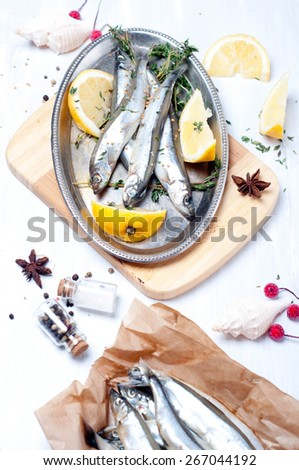 fresh fish with spices on wooden table, preparation
