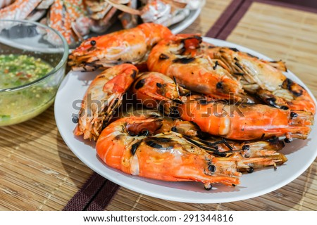 fresh flaming shrimp with chili sauce, delicious seafood - stock photo