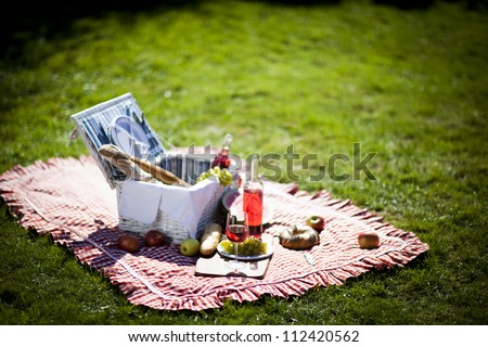 Fresh food from picninc basket in the garden! - stock photo