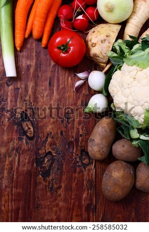 Fresh food on wooden table - stock photo