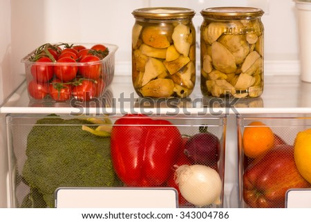 Fresh food, vegetables and fruits on the shelves in the fridge - stock photo