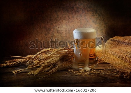 Fresh fragrant foamy beer of light grades in a transparent glass beer mug - stock photo