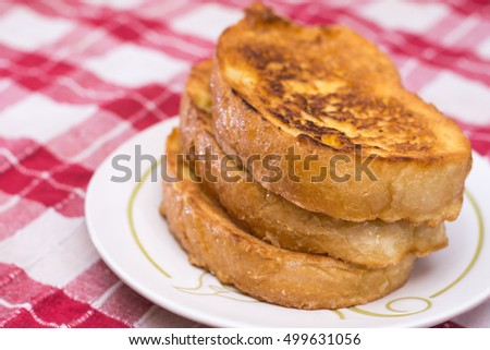 Fresh french toast bread on eggs