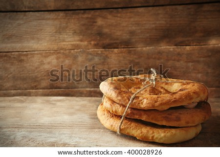 Fresh fried bread on wooden background