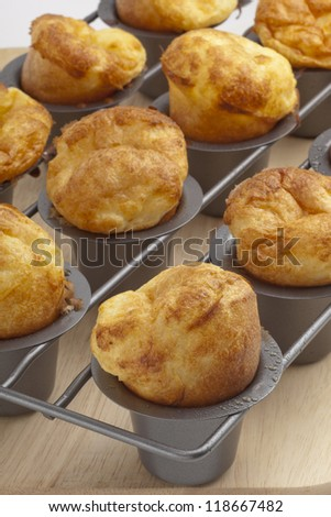 Fresh from the oven crunchy popovers - stock photo