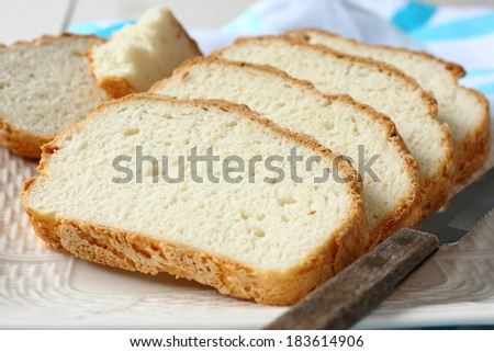 Fresh from the oven sliced gluten free bread on plate - stock photo