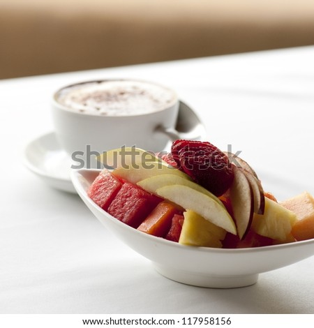 Fresh fruit and cappuccino cup on a table setting in Costa Rica - stock photo