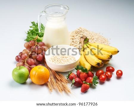 fresh fruit and milk on white background - stock photo