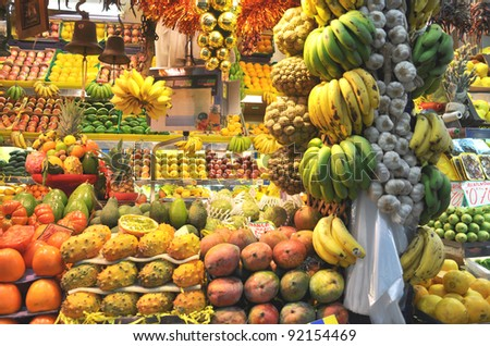 Fresh fruit at a market stall, banana and garlic