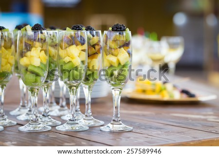Fresh fruit cuts in champagne glass - stock photo