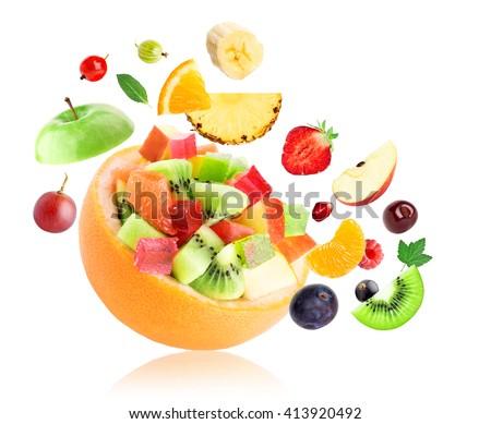 Fresh fruit. Fruit salad on white background  - stock photo