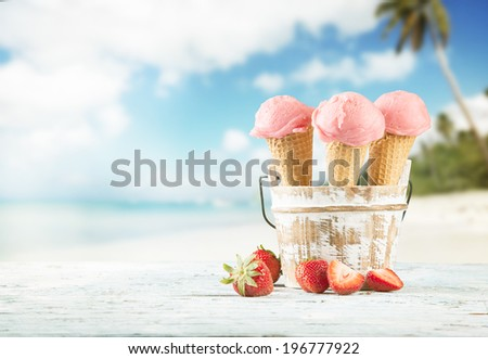 Fresh fruit ice cream scoops in cones, blur beach on background - stock photo