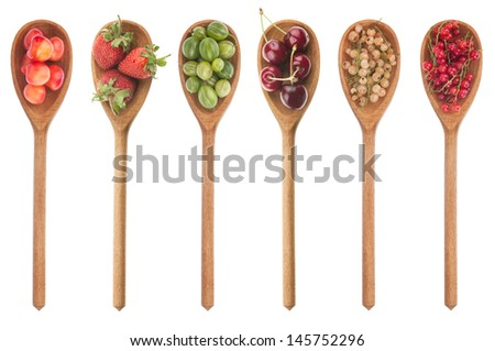Fresh fruit in a wooden spoon isolated on a white background - stock photo