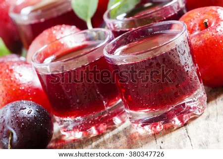 Fresh fruit juice of red plums and peaches, selective focus - stock photo
