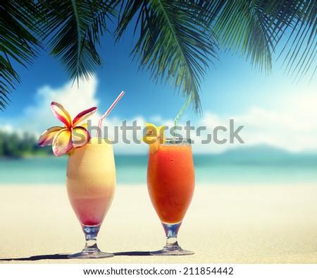 fresh fruit juices on a tropical beach - stock photo