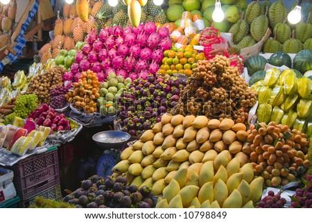 Fresh fruit market in Asia at night. - stock photo