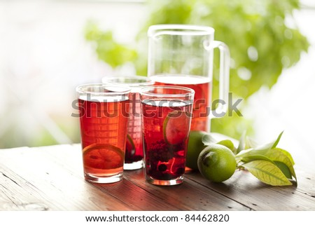 fresh fruit punch made with pieces of fruit inside and fresh lime - stock photo