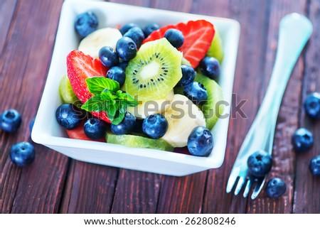 fresh fruit salad in the white bowl - stock photo