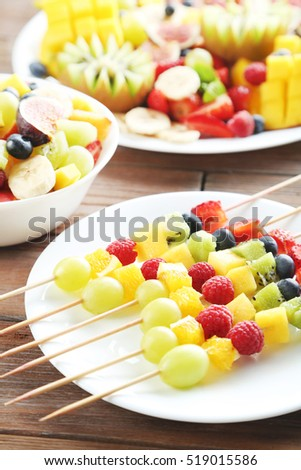 Fresh fruit salad on a brown wooden table