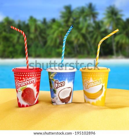 fresh fruit smoothies on a tropical beach - stock photo