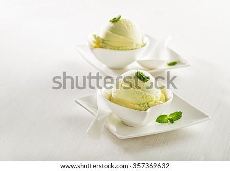 Fresh fruit sorbet ice cream in a white bowl. - stock photo