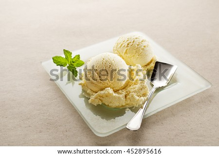 Fresh fruit sorbet ice cream in a white bowl close up