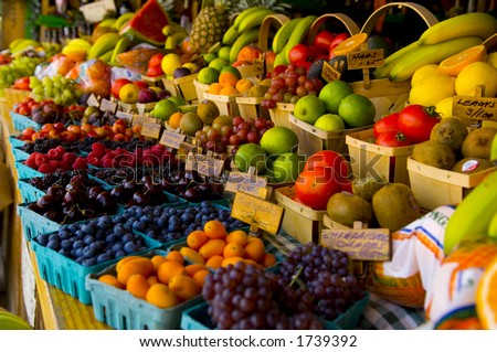Fresh fruit stand with boysenberries, raspberries, cherries and grapes