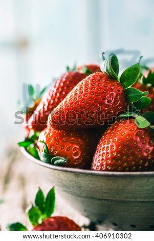 Fresh fruit. Strawberries on wood. Spring fruit. - stock photo