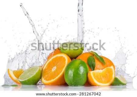 Fresh fruit with water splash on white background - stock photo