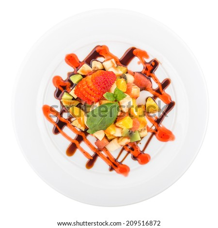 Fresh fruits and berries on a plate isolated on white background. Clipping path - stock photo