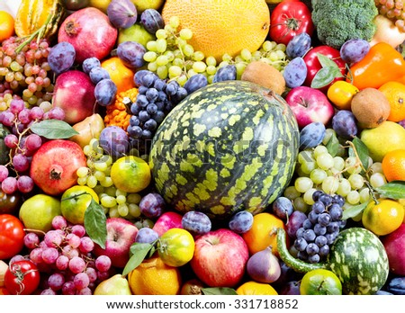fresh fruits and vegetables as background - stock photo