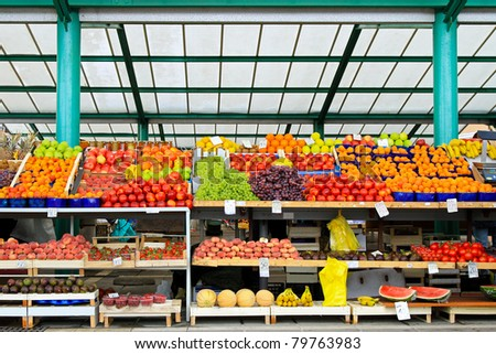 Fresh fruits and vegetables at farmers market stall - stock photo