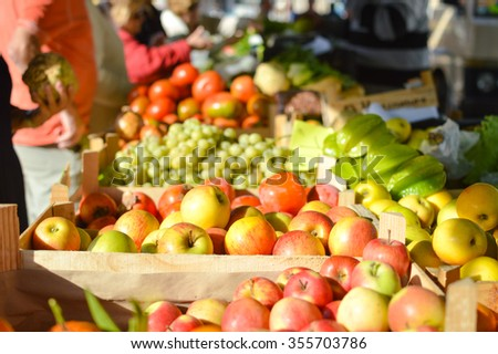 Fresh fruits and vegetables at market in boxes - stock photo