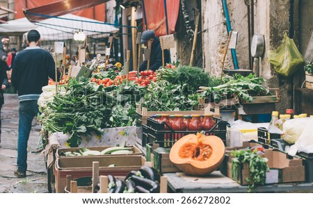 Fresh fruits and vegetables for sale in Ballaro, famous market in Palermo, Sicily island, Italy. Toned image - stock photo