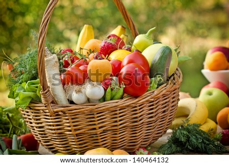 Fresh fruits and vegetables in the wicker basket