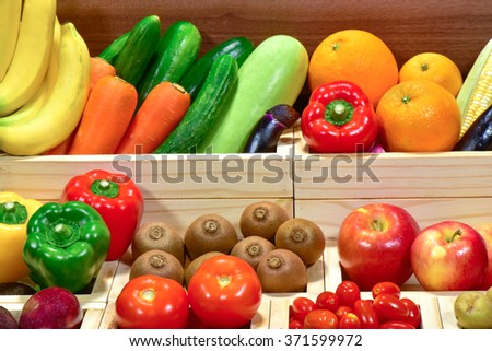 Fresh fruits and vegetables in wooden box at the supermarket - stock photo