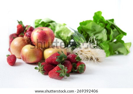 Fresh fruits and vegetables on desk - stock photo