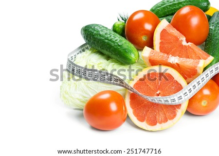 Fresh fruits and vegetables on white background. Diet concept - stock photo
