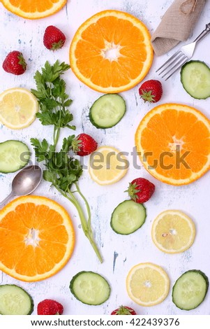 Fresh fruits and vegetables on white wooden table. - stock photo