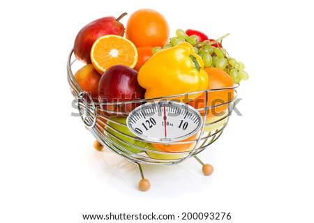 fresh fruits in a basket isolated on white background. Basket with weight scale, diet concept - stock photo