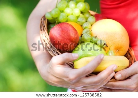 Fresh fruits in basket - stock photo
