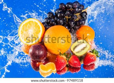 Fresh fruits in water splash - stock photo