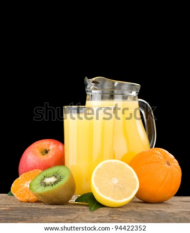 fresh fruits juice in glass and slices isolated on black background - stock photo