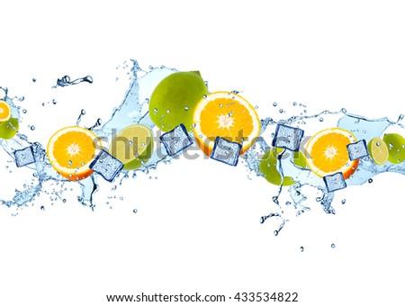 Fresh fruits, lime, orange falling in water splash, isolated on white background - stock photo