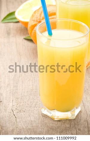 fresh fruits orange juice in glass on wood table background - stock photo