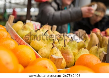 Fresh fruits ready for sale at marketplace. Pears. Shallow depth of field. - stock photo