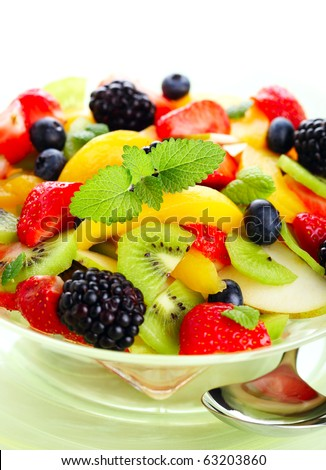 Fresh fruits salad on white isolated background - stock photo
